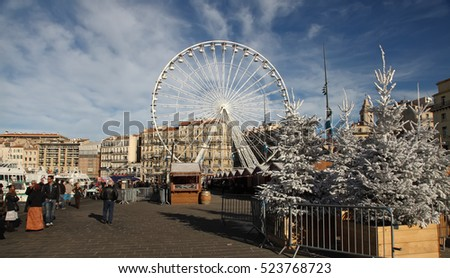 France, Marseille - November 19, 2015: Tradishional Christmas market with ferris wheel in Old port (Vieux-Port). Marseille is France's largest city on the Mediterranean coast and large commercial port