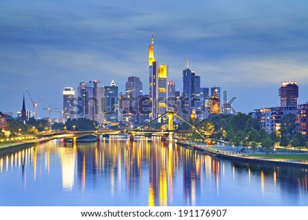 Frankfurt am Main. Image of Frankfurt skyline after sunset with the reflection of the city in Main River.