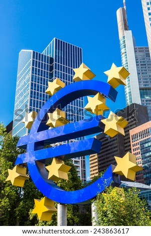 FRANKFURT, GERMANY - JULY 9: Euro sign. European Central Bank headquarters in Frankfurt in Germany  in summer day on July 9, 2014 in Frankfurt, Germany