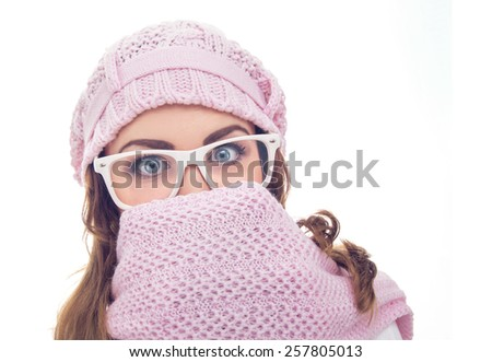Freezing young woman stare wearing scarf or winter clothing, isolated on white. Close up studio shot