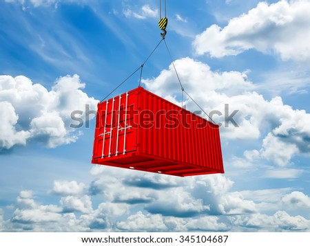 Freight shipping container hanging on crane hook against clouds