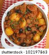 French beef stew with new potatoes, olives and capers. - stock photo
