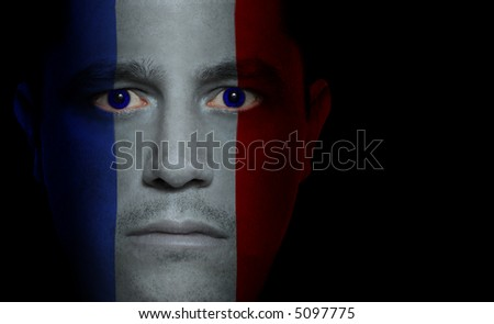 French flag painted/projected onto a man's face.