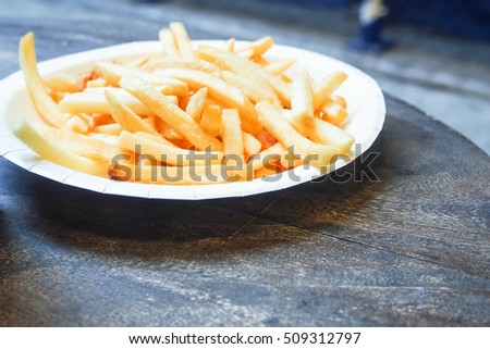 french fries on wooden table street food