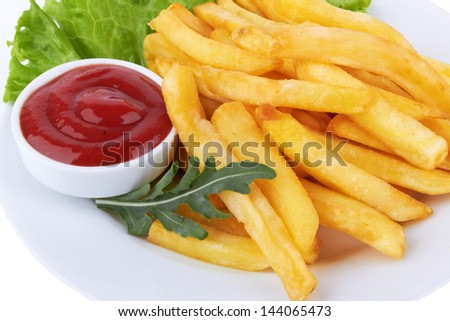French fries with ketchup closeup over white