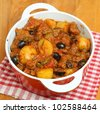 French Provencal beef stew with new potatoes and olives. - stock photo
