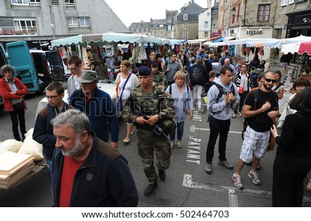 FRENCH SECURITY - AUGUST 2016 - FRENCH PATROL: A french soldier patrols the streets of Vannes, France during a weekend street market.