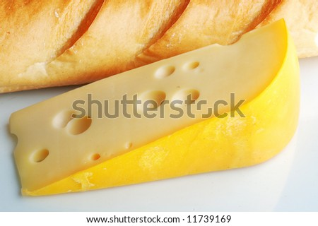 fresh and tasty slice of cheese and bread, close-up, on table