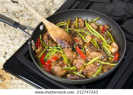 Fresh Asian style beef stir fry with green beans, peppers, onions in ...