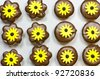 Fresh baked marshmallow cookies with yellow flowers on top - stock