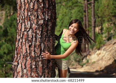 Fresh beautiful smiling woman in summer forest playful. Image from pine tree forest near Vilaflor, Tenerife, Canary Islands.