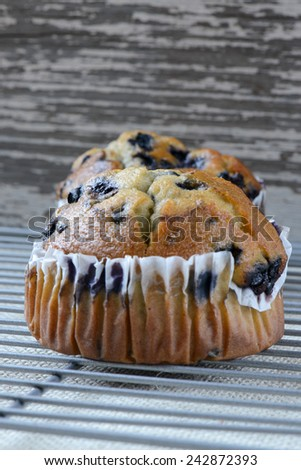 Fresh Blueberry Muffins on Rustic Burlap Background