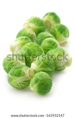 Fresh brussel sprouts isolated on white background.