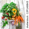 Fresh carrot on wooden background - stock photo