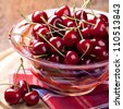 Fresh cherries in bowl on table - stock photo