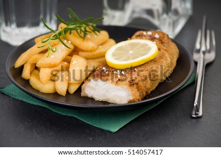 Fresh codfish fillet with chips