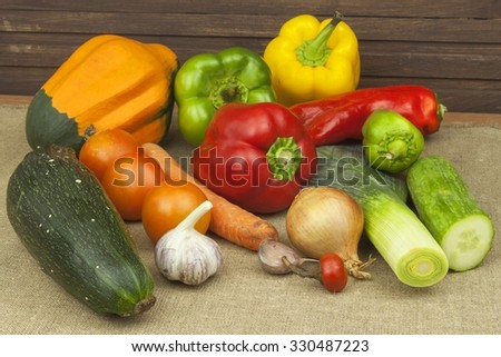 Fresh colorful vegetables on table. Fresh vegetables ready for processing. Kitchen table, ready for cooking vegetable dishes. Healthy diet food.