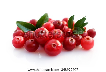 Fresh cranberries with leaves isolated on white
