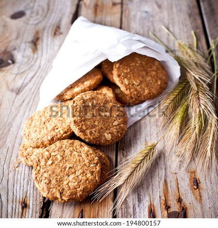 fresh crispy cereal cookies and ears on rustic wooden table