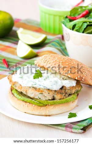 Fresh, delicious chicken burger in the Greek style with zucchini and yogurt cucumber sauce tzatziki