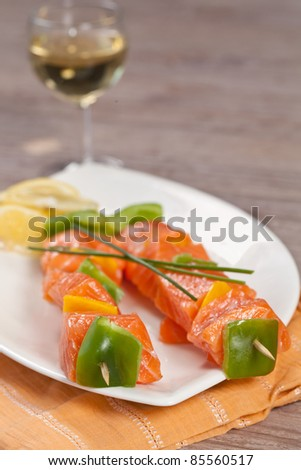 Fresh delicious salmon fish skewer on a plate