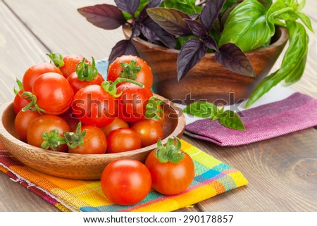 Fresh farmers tomatoes and basil on wood table