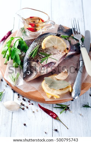 Raw fresh river fish fish on 500818591 shutterstock for Aromatic herb for fish