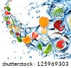 Fresh fruit splash with ice cubes - stock photo