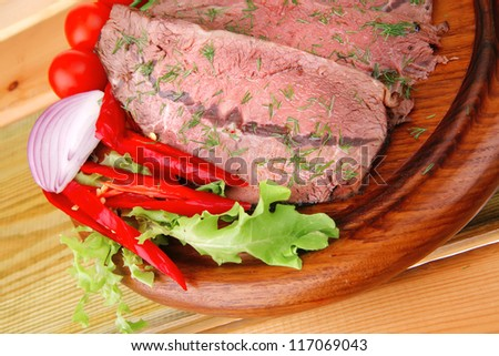 fresh grilled beef slice on wooden plate