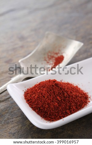 fresh ground saffron powder in white dish