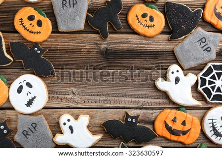 fresh halloween gingerbread cookies on brown wooden table - Halloween Gingerbread Cookies
