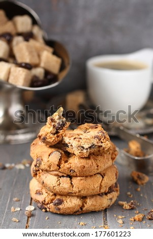 Fresh homemade chocolate chip cookies with cup of espresso on old wooden background