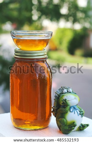 Fresh honey harvest in the jar for a healthy vegetarian breakfasts