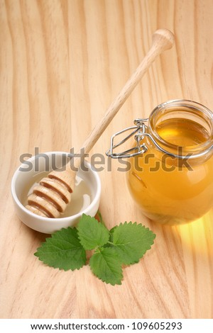 Fresh honey on the wooden table