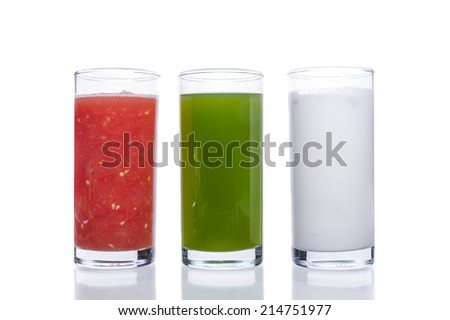 Fresh juice from fruits and vegetables in a glass on a white background.