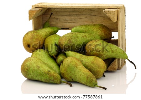 fresh juicy pears coming out of a wooden box on a white background