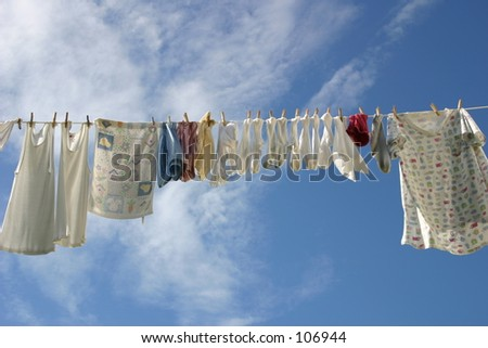 fresh laundry hanging on a clothesline in the blue sky.