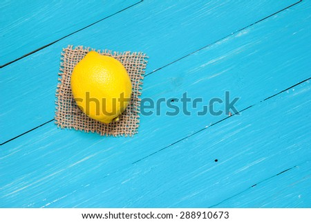 Fresh lemon on turquoise boards