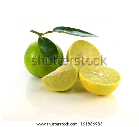 Fresh lime with green leaf. Isolated on white