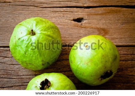Fresh Natural Green Guava on Wood Table Background, Rustic Still Life Style.