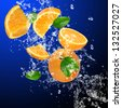 Fresh oranges in water splash - stock photo