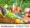 Fresh organic vegetables in wicker basket - stock photo