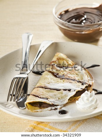 Fresh pancakes with chocolate close up shoot