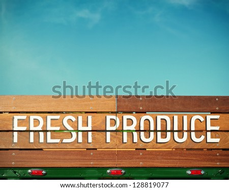 Fresh produce hand painted wooden sign on a vintage green truck with room for your own message