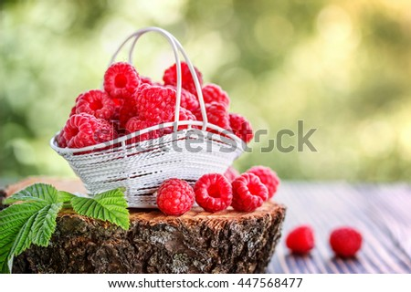 fresh raspberry on a wooden table outdoors outdoors