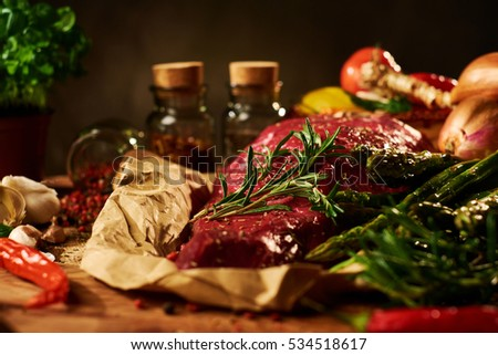Fresh raw meat with herbs, spices and vegetables