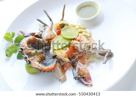Fresh raw sea crab served with spicy Thai style seafood sauce on white background, delicious and famous in Thailand.
