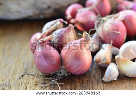 Fresh red onions on a wooden background
