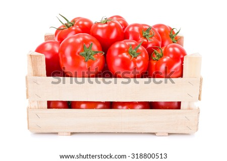 Fresh ripe tomatoes (Solanum lycopersicum) in wooden crate