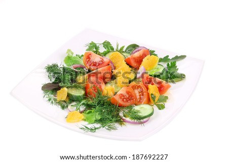 Fresh salad. Isolated on a white background.